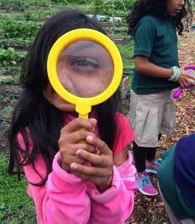 Elementary Student with a magnifying glass